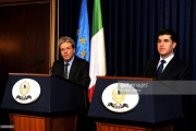 ARBIL, IRAQ - DECEMBER 23: Kurdish Regional Government Prime Minister Nechirvan Barzani (R) and Italian Foreign Minister Paolo Gentiloni (L) attend a joint press conference following their meeting in Arbil, Iraq on December 23, 2014. (Photo by Hamit Huseyin/Anadolu Agency/Getty Images)